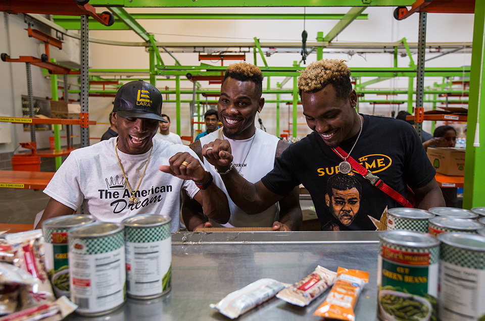 JERMELL CHARLO & ERISLANDY LARA VOLUNTEER AT THE HOUSTON FOOD BANK TO HELP THOSE AFFECTED BY HURRICANE HARVEY